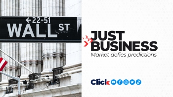 The Dow briefly set a record high Wednesday.